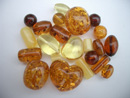 Mixed drilled and undrilled round amber beads - loose beads