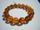 Stretch amber bracelet - round cognac color beads