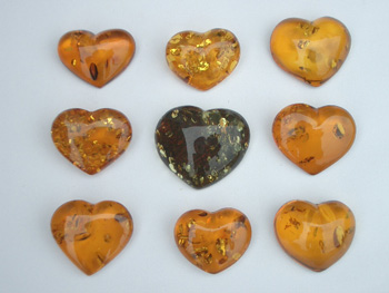 Natural clear honey, green amber heart pendant with spangles. Loose amber hearts with spangles.