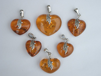 Natural clear honey amber heart pendant with sterling silver leafs.