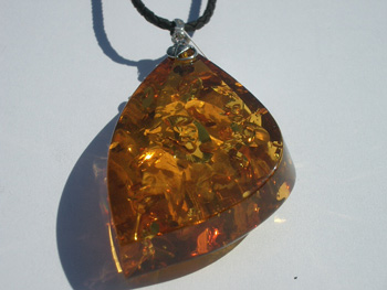 Cognac color Baltic amber pendant - on eather cord with 925 sterling silver mount
