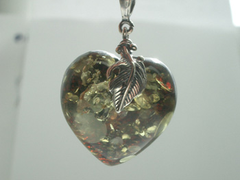 Natural green Baltic amber heart pendant with spangles.