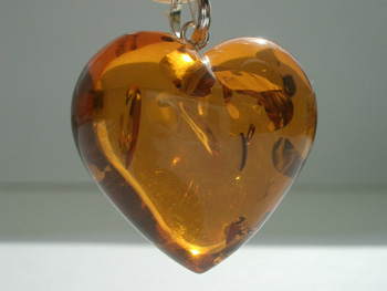 Dark honey colour amber pendant